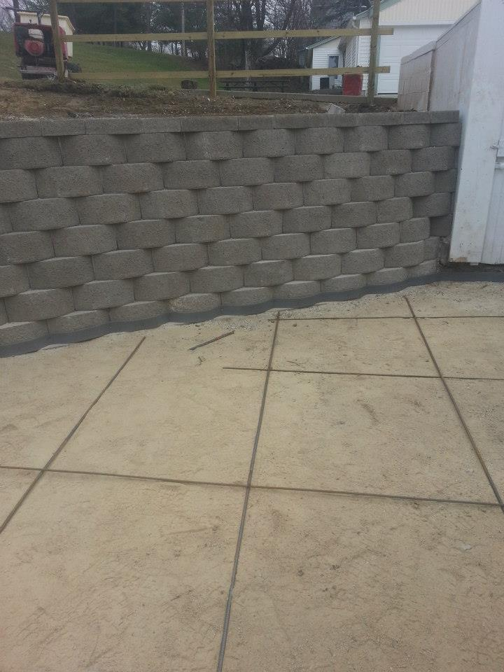 New retaining wall and patio poured into backyard of residential home.